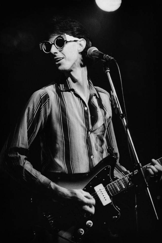 The Cars Ric Ocasek performs on stage in a punk history book by music photographer Michael Grecco